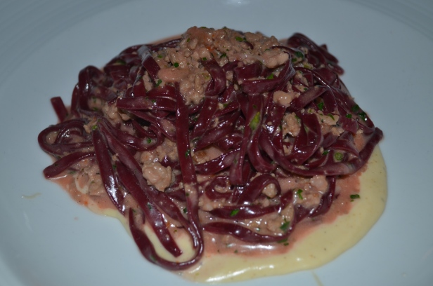 Red beet tagliolini with marsala quail ragu and taleggio fondue