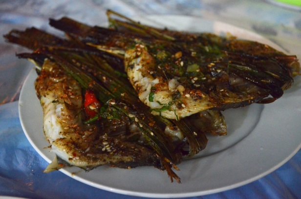 House of Haos Xishuangbanna Yunnan BBQ grilled fish sweet grass