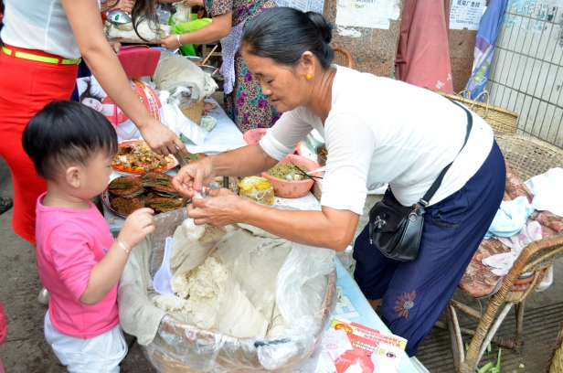 House of Haos Xishuangbanna Menghai Aini Village Market Child Buying Sticky Rice 1