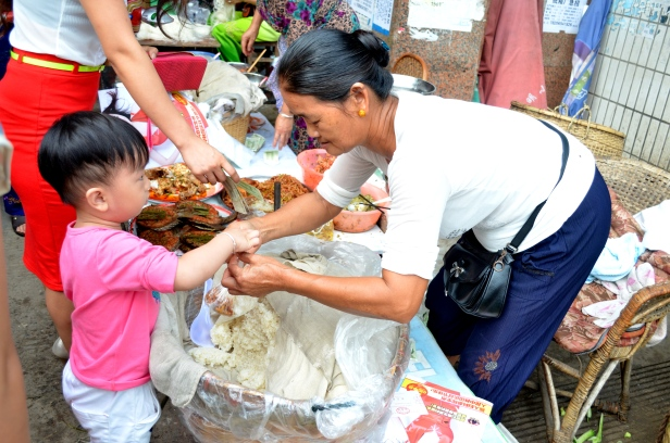House of Haos Xishuangbanna Menghai Aini Village Market Child Buying Sticky Rice 2
