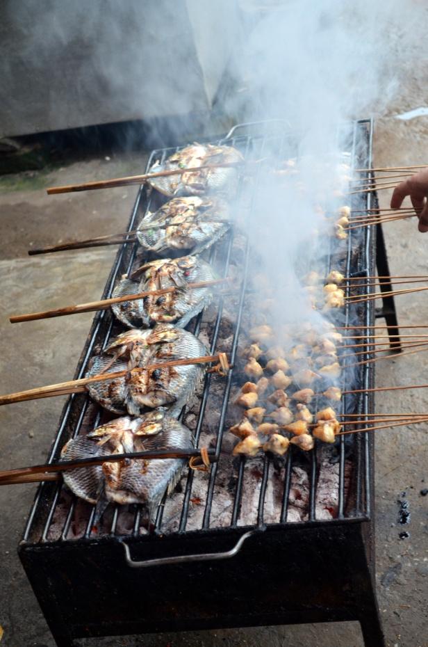 House of Haos Xishuangbanna Menghai Aini Village Market Grilling Fish