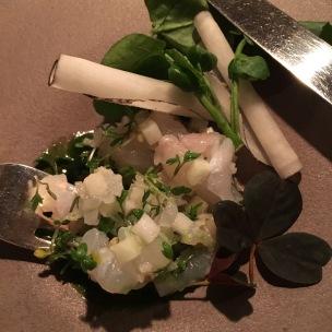Skrei cod crudo, gooseberries, watercress, broad bean cream, black radish at Oaxen Krog Stockholm