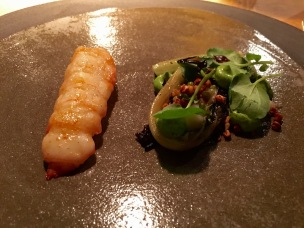 Langoustine with ramson, grilled Skilleby salad, dried lard, roasted buckwheat at Oaxen Krog Stockholm