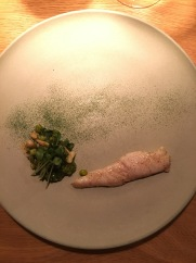 Baked turbot with kale from Oaxen garden, almonds, fried pickled peas at Oaxen Krog Stockholm